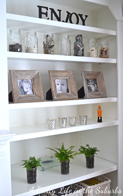 Adding potted plants to shelves is such a great idea!