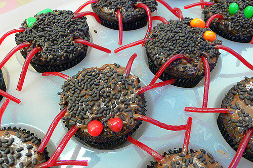 spider cupcakes with red legs and red evil eyes