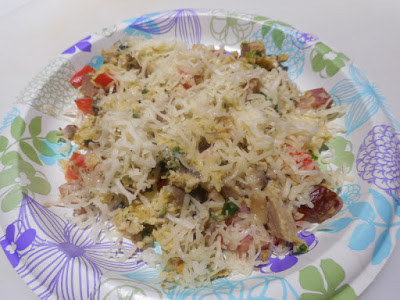Egg Scramble: bacon, red peppers, green onions, eggs, topped with grated cheese