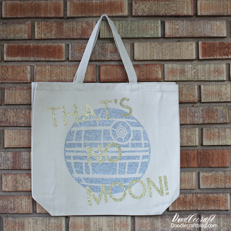 "Cream canvas tote bag with silver glitter vinyl Death Star and Gold glitter ""that's no moon!"" phrase"