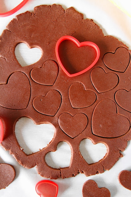 Valentine Chocolate Sugar Cookies ~ Heart-shaped cookies adorned with candy melts & sprinkles create a perfect simple treat to share the Valentine love!  www.thekitchenismyplayground.com