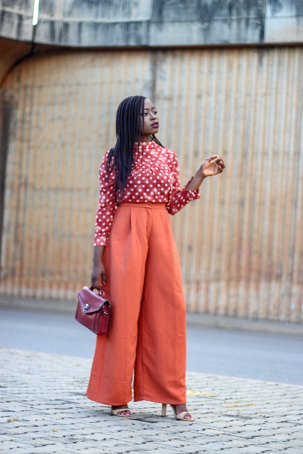 Polka-dot top and orange high waist trousers