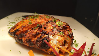 Crisp and golden Tandoori Pomfret Food recipe
