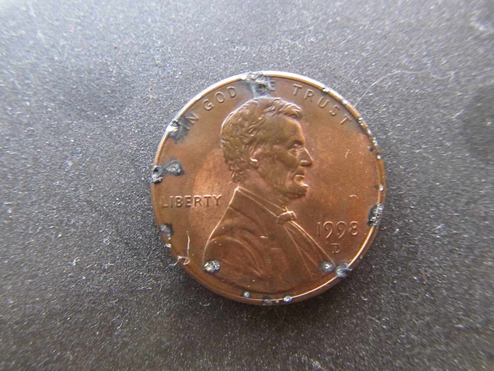 A Penny With Electrical Damage; from being inside of a 2001 Honda odyssey CD Player; www.DarrellWolfe.Com