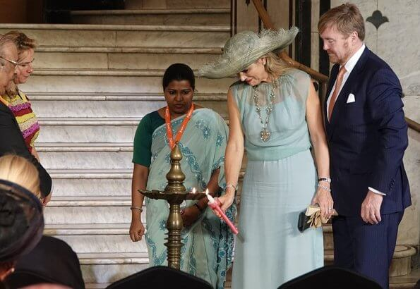 Queen Maxima wore Sandro blue ring detail midi dress. Queen Maxima wore a new turquoise green tulle dress by Natan