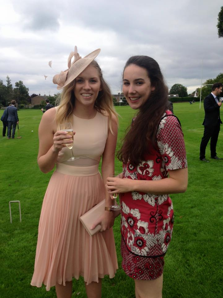 Rachel Emily with a friend wearing a pale pink ASOS dress and fascinator