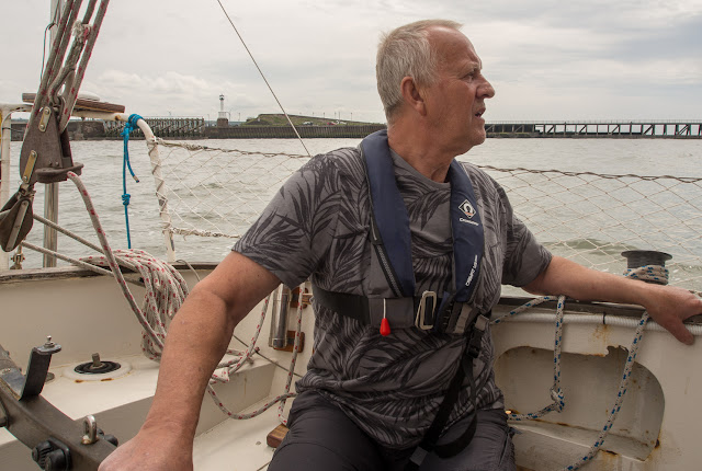 Photos of Phil taking the tiller for our trip out in the Solway Firth