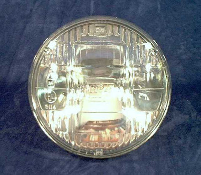Image of a Lucas 5712 Sealed beam headlamp on a blue background