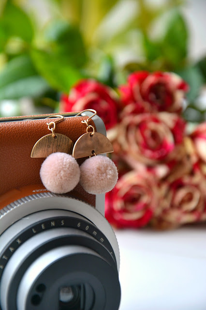 Instax Mini 90 Retro Camera; Happiness Boutique Pom Pom Earrings; Marbled Red & Cream Roses