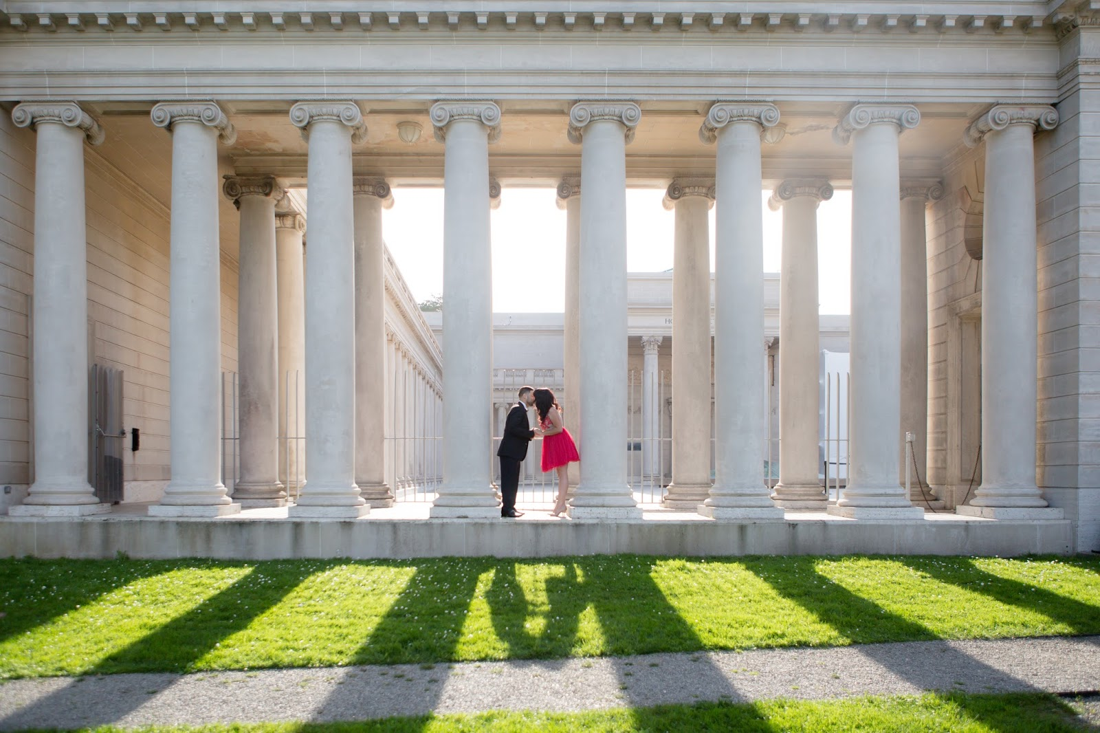 Legion of Honor Couple kissing near pillars