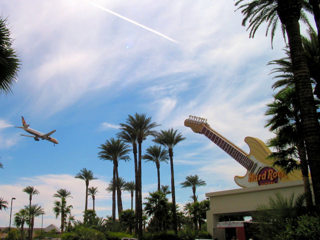 Jet flies over Hard Rock Hotel Vegas giant Fender Stratocaster sign