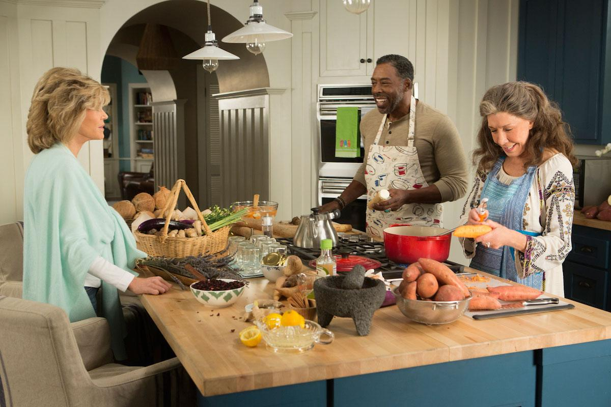 Grace and Frankie beach house kitchen island with butcher block top and blue cabinets. #graceandfrankie