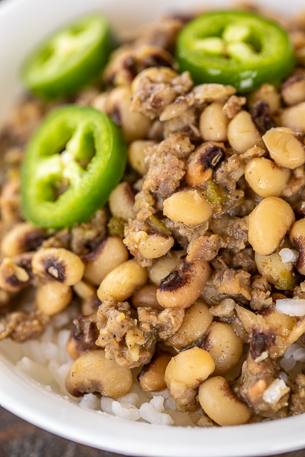 Black Eyed Peas with Sausage and Jalapeños - the BEST black eyed peas EVER! I could make a meal out of these yummy peas!!! Frozen black eyed peas, sausage, jalapeños, garlic, salt, onion, cumin, sage, chicken broth. A must for your New Year's Day meal. Great side dish! #sidedish #blackeyedpeas #sausage