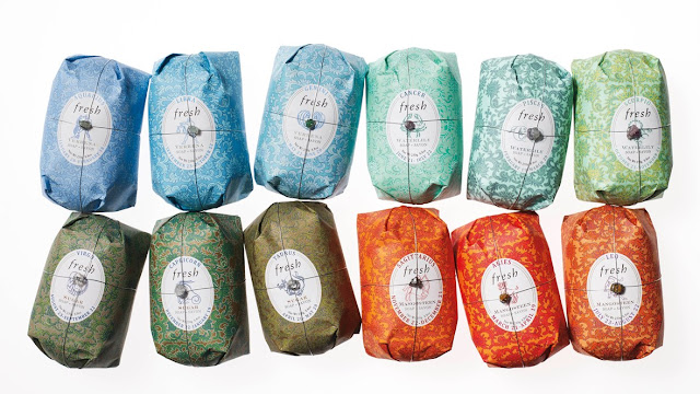 Fresh Beautifully scented Zodiac Soaps in brightly coloured thick gift wrap with wire tied gemstone