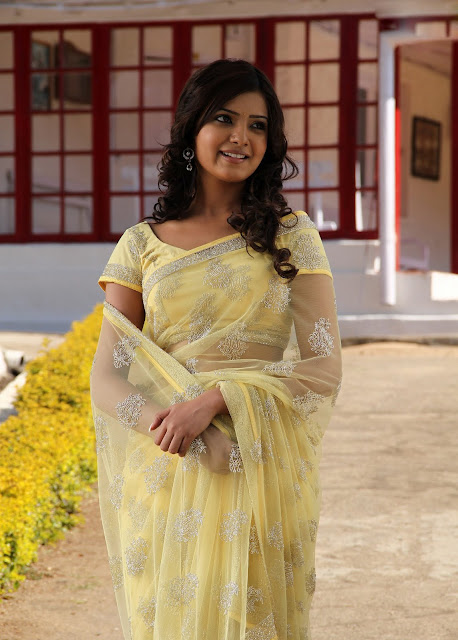 Glamorous Samantha Stills in Yellow Saree