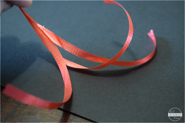 cut-several-strips-of-curling-ribbon