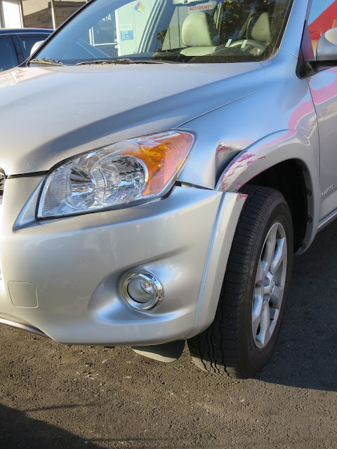 Dented fender and scraped bumper on 2012 Rav4 before collision repairs at Almost Everything Auto Body