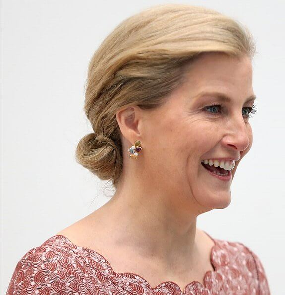 The Countess of Wessex wore Alaïa Multicolor scalloped eyelet lace dress, heavenly necklaces diamond earrings. Gianvito Rossi