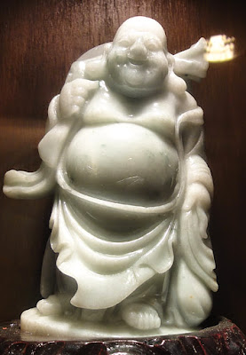 Laughing pure white jade Buddha statue