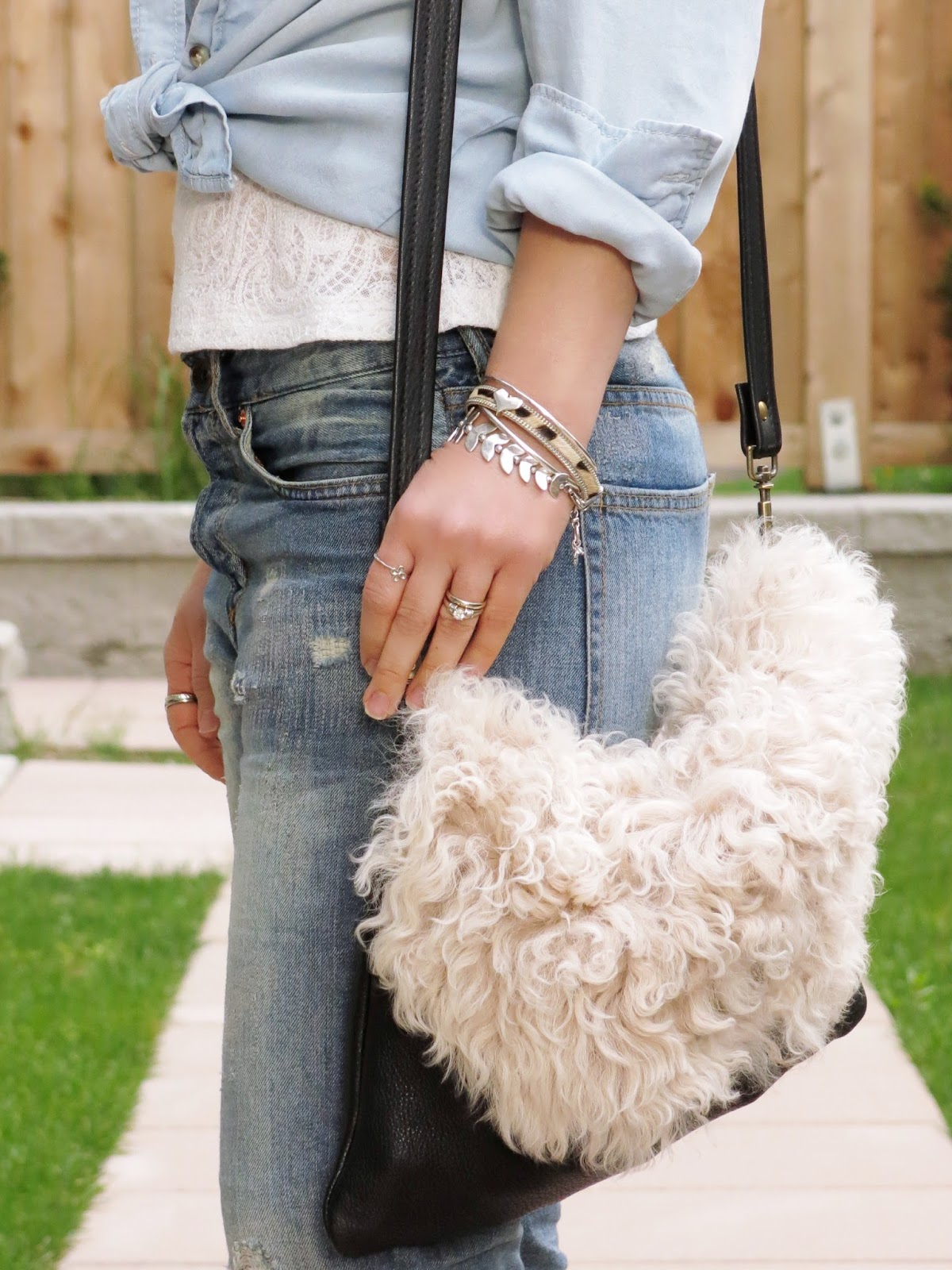 boyfriend jeans, lacy top, chambray shirt, sherpa bag