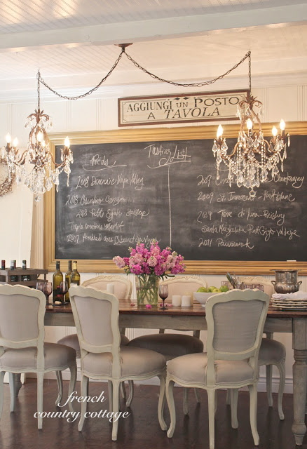 Dining room with two chandeliers