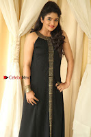 Kannada Actress Divya Uruduga Pos in Black Long Dress at Huliraaya Movie Audio Release Event  0007.jpg