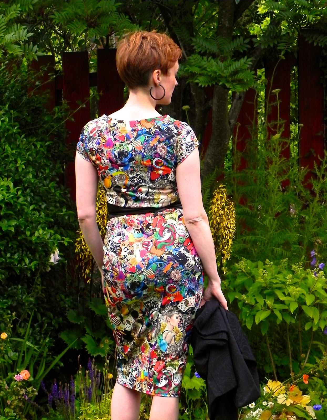 Patterned dress, vintage kimono, black leather obi belt. Back view
