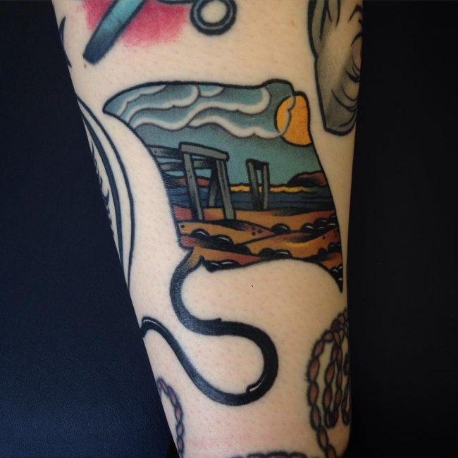 tatuaje de mantarraya con paisaje de playa