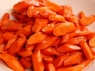 Glazed carrots with orange and ginger recipe are a tasty favorite North African dish.