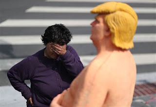 A passerby looks at a statue depicting Republican presidential nominee Donald Trump in the nude in San Francisco!