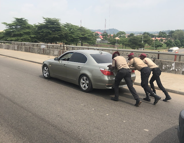 Officers of FRSC in lagos help nigerian push his car