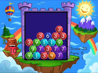 http://www.education.com/game/number-pairs-bubble-buster/