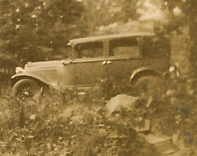 This might be the 1926 Overland Coach owned by Wallace B. Dixon. This photo is from his collection, privately held by E. Ackermann. The image has been cropped, removing a cottage and two unidenified people. 2016.