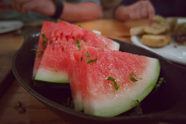 Sliced watermelon, torn basil, Cellar Sea Salt, Georgia olive oil