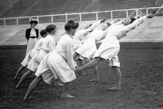 Danish gymnastics team. Exhibition at the London Olympics in 1908. The gymnasts hold their teammates' feet while they stretch. Your Russians are missing and other stories about past Olympics. marchmatron.com