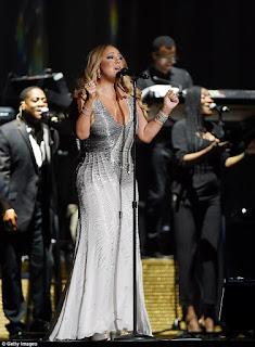 Mariah Carey and Bryan Tanaka on stage