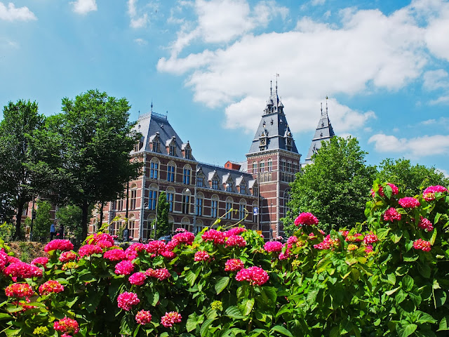 The Royal Concertgebouw with pink hydrangeas in the foreground.