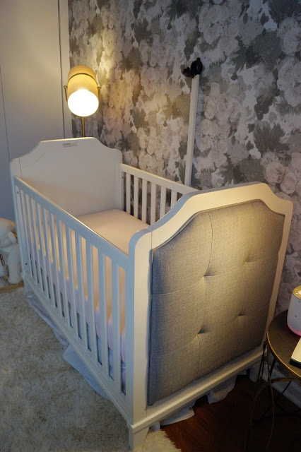 Tufted crib & floral wallpaper for baby girl nursery