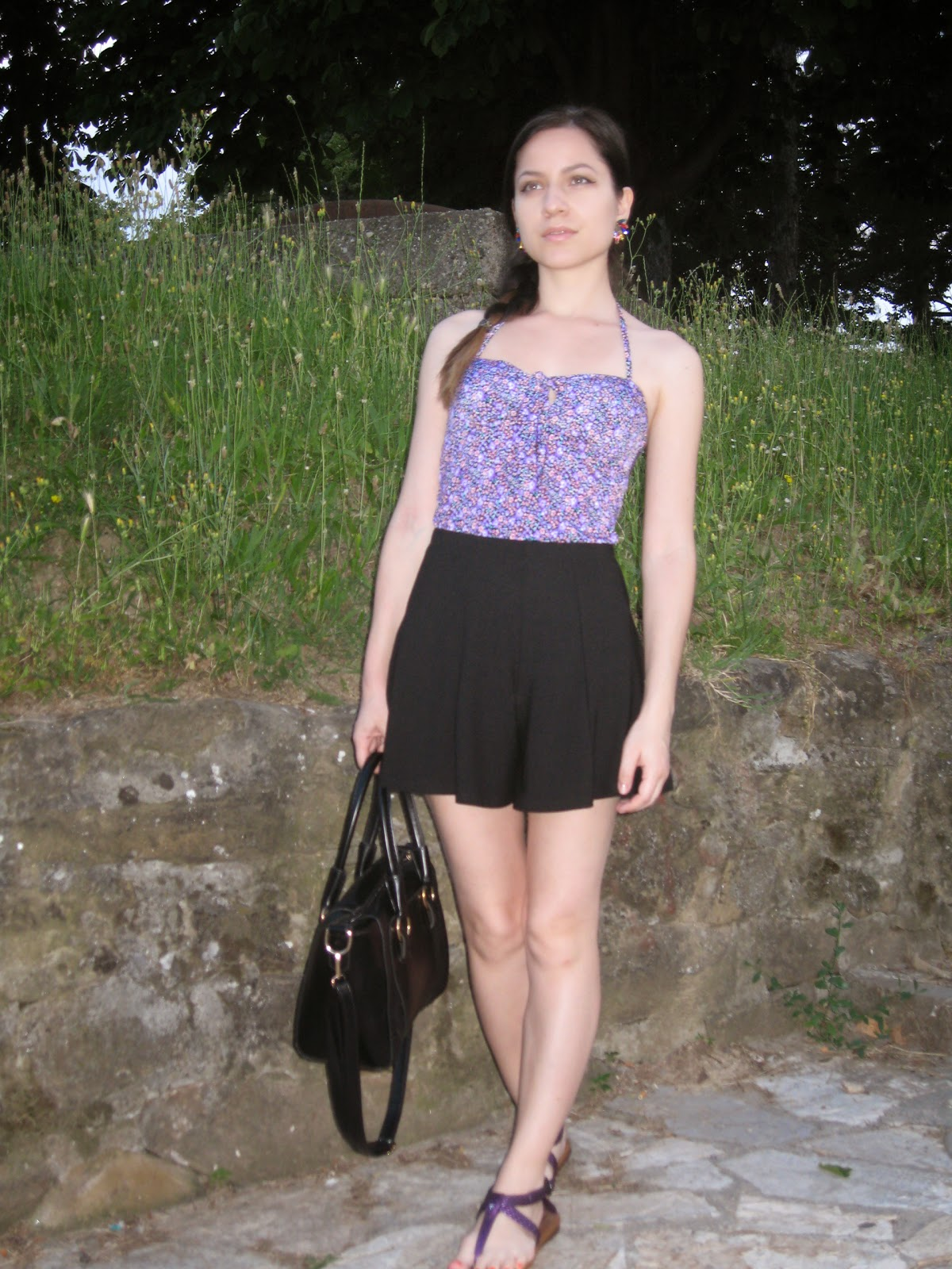 black flared high waisted shorts, black tote bag, purple floral flowers fitted top, side braid, purple flip flops flat sandals, styling high waisted shorts, colorful rhinestone earrings