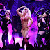 Singer Britney Spears performs through wardrobe malfunction after her top slips off