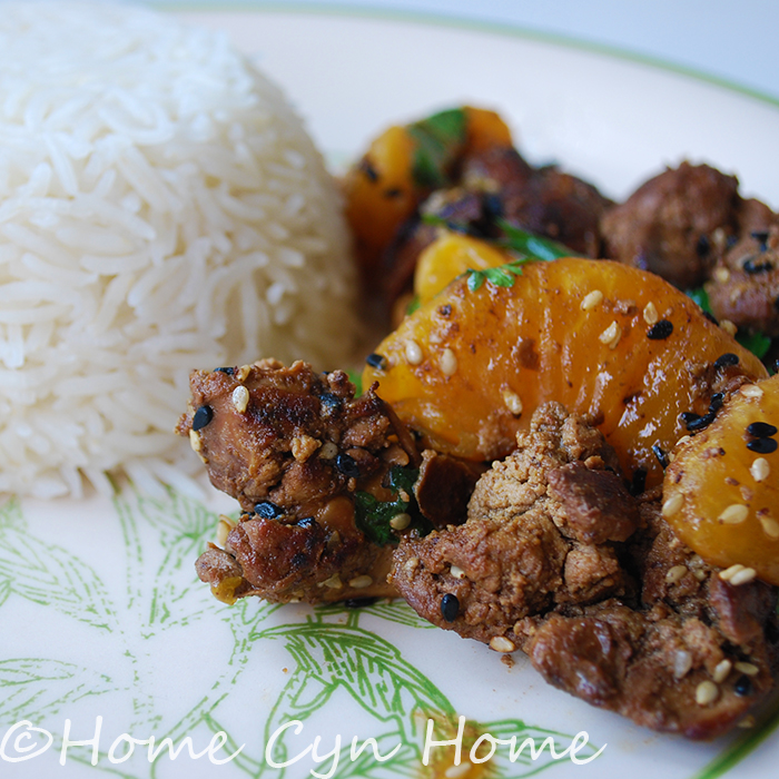 stir fried chicken livers with tangerine wedges and sesame seeds