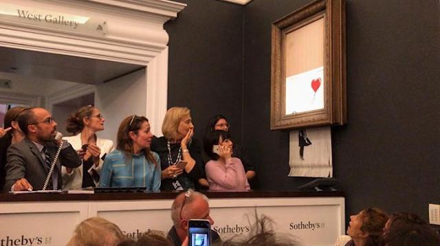 Obra de Banksy autodestrói-se depois de ser vendida por 1,2 milhões de euros
