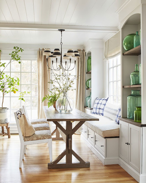 dining room with green glass carboys