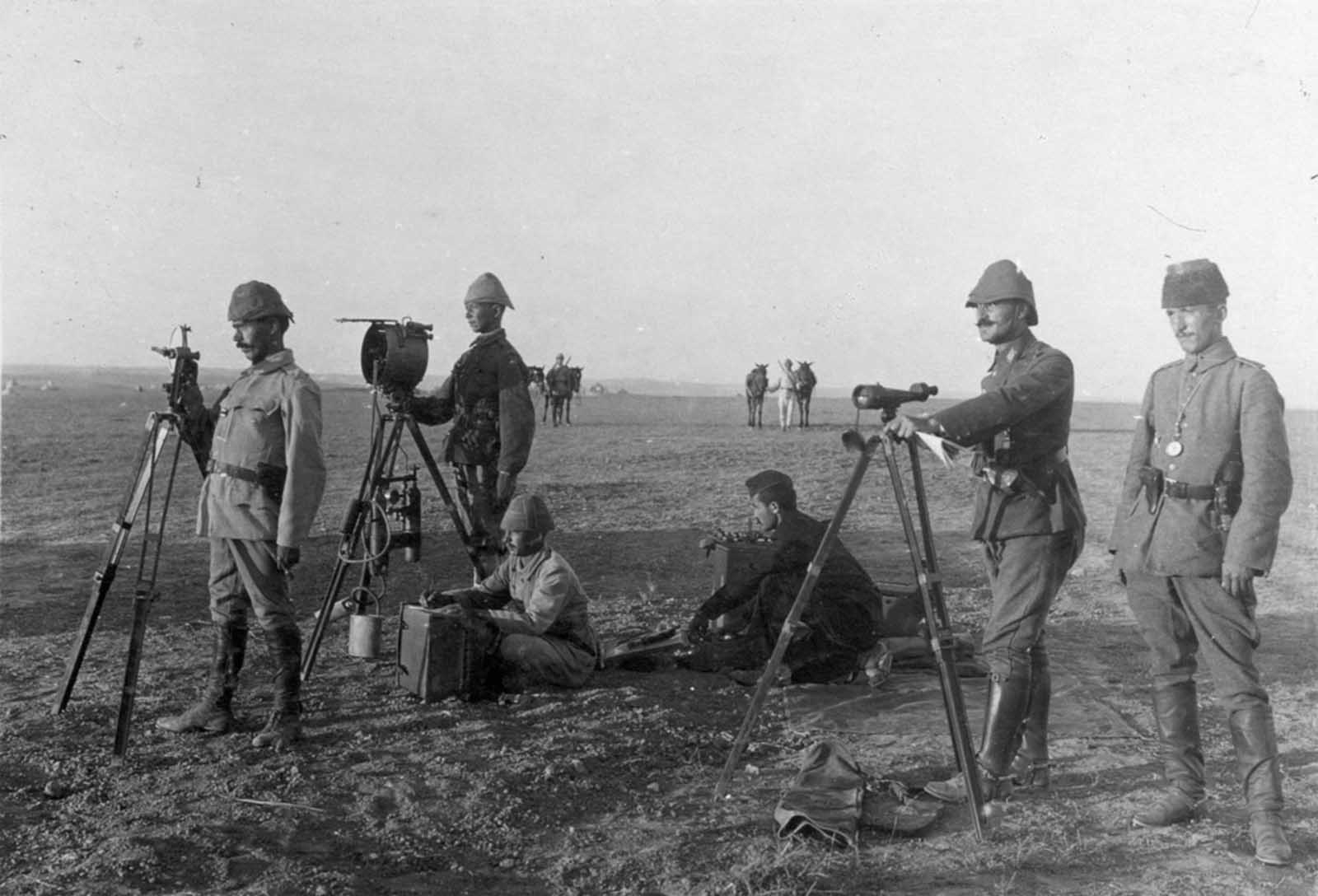 Turkish troops use a heliograph at Huj, near aza City, in 1917. A heliograph is a wireless solar telegraph that signals by flashes of sunlight usually using Morse code, reflected by a mirror.