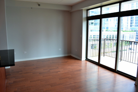 Family room in our new Chicago Apartment. Guess where those doors lead! That's right - the balcony!