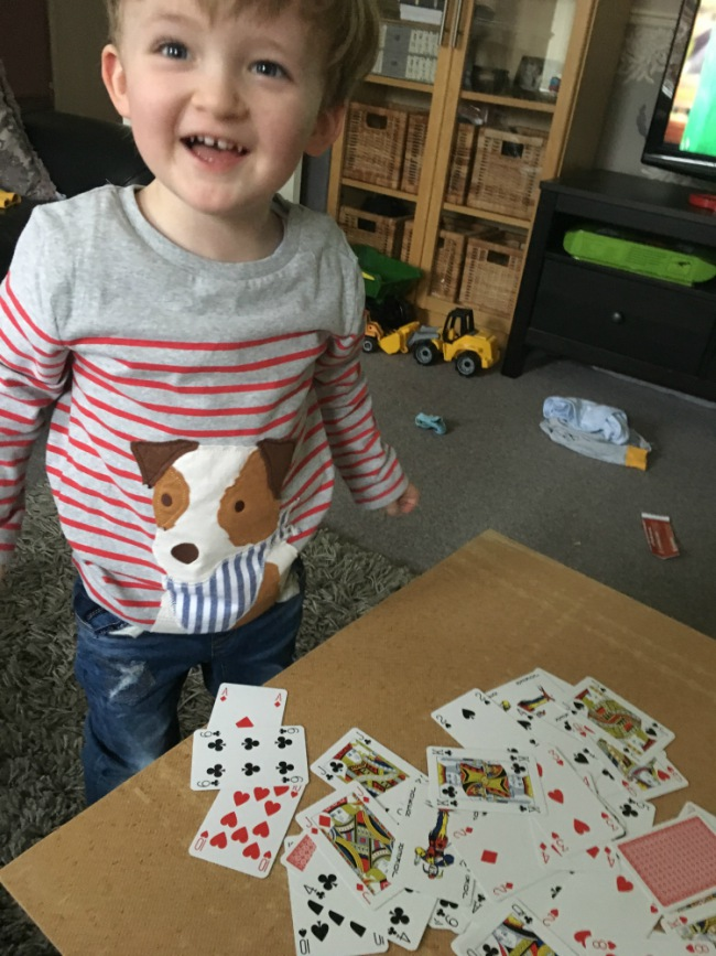 our-weekly-update-19-feb-2017-toddler-grinning-next-to-pile-of-playing-cards