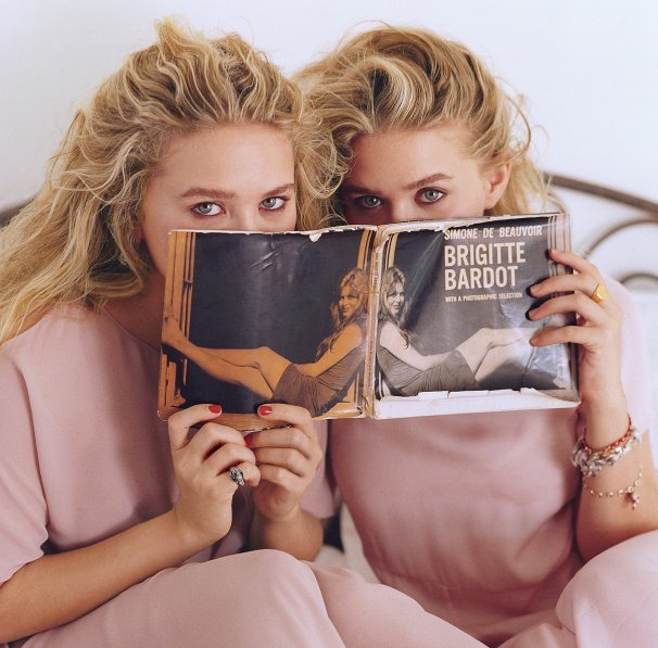 Olsen Twins hiding behind Brigitte Bardot book