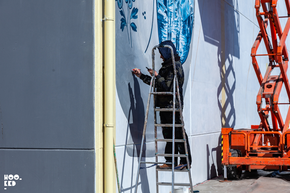 Leon Keer at work painting his 3d mural fragile in ostend, belgium