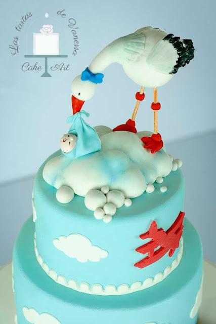 tarta de fondant  bautizo cigüeña, tren y avión, rojo, azul y balnco