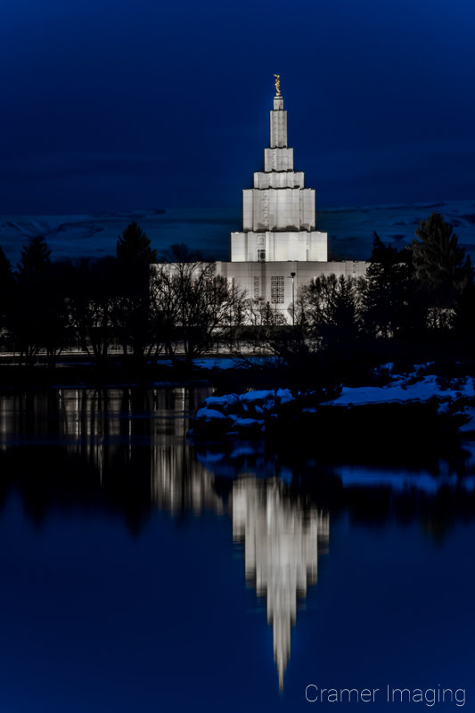 Cramer Imaging's fine art photograph of the Idaho Falls LDS Temple at twilight in winter with Snake River reflection